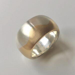 Wellenring aus 925/000 Silber und 750/000 Gelbgold